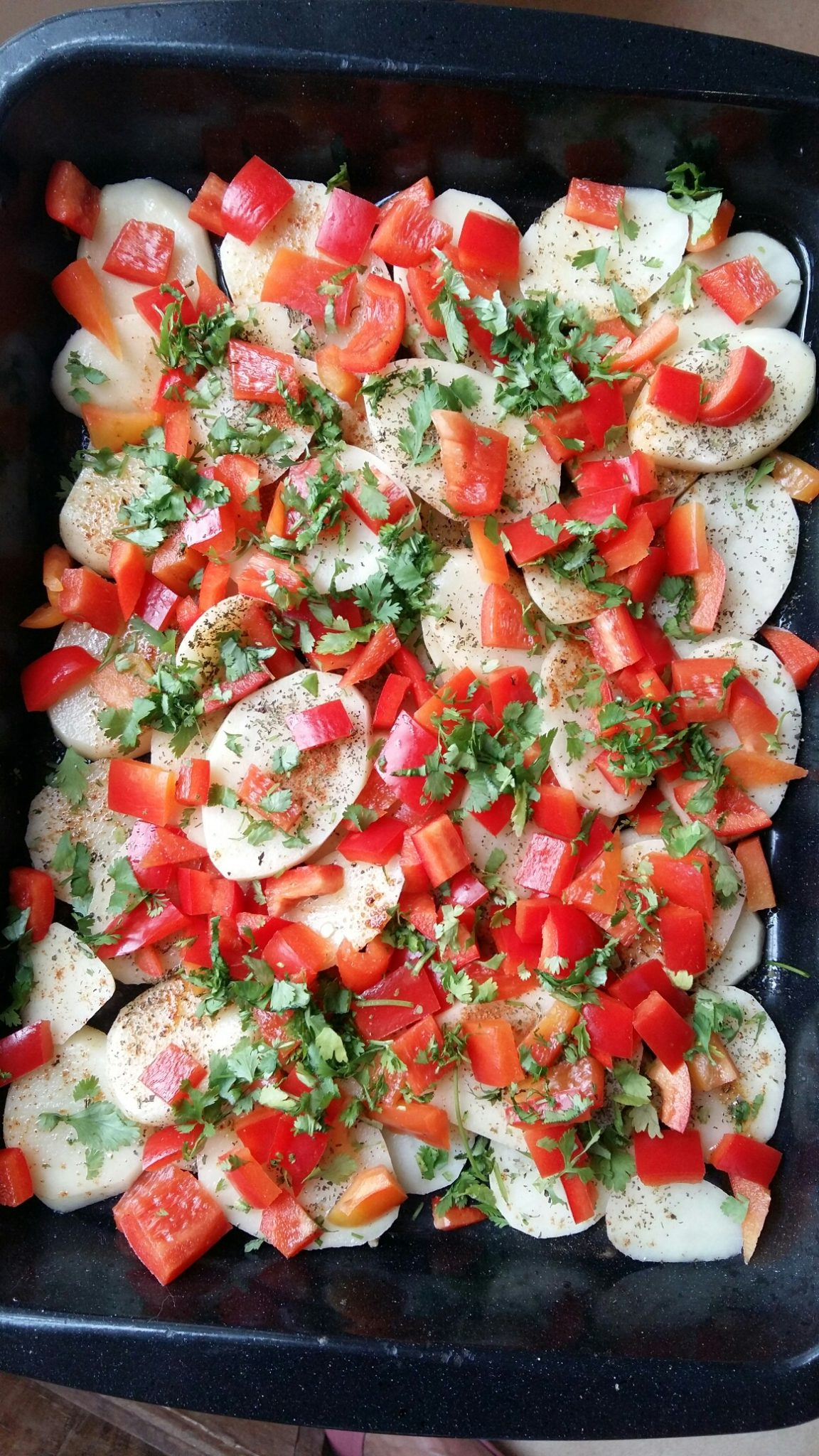 Scatter over chopped sweet red pepper, chopped fresh coriander and Italian parsley