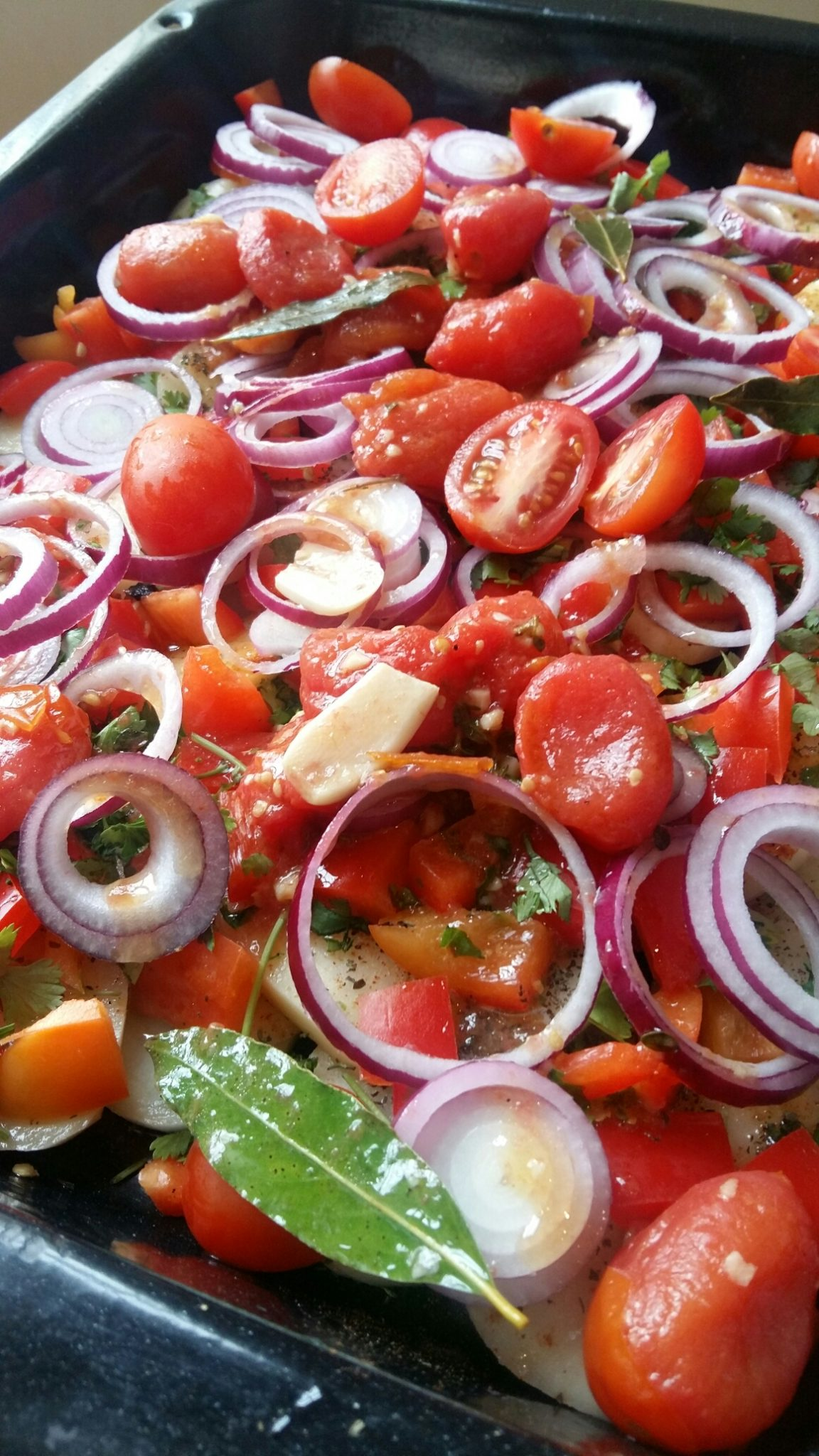 Add halved cherry plum tomatoes and red onion rings plus seasonings