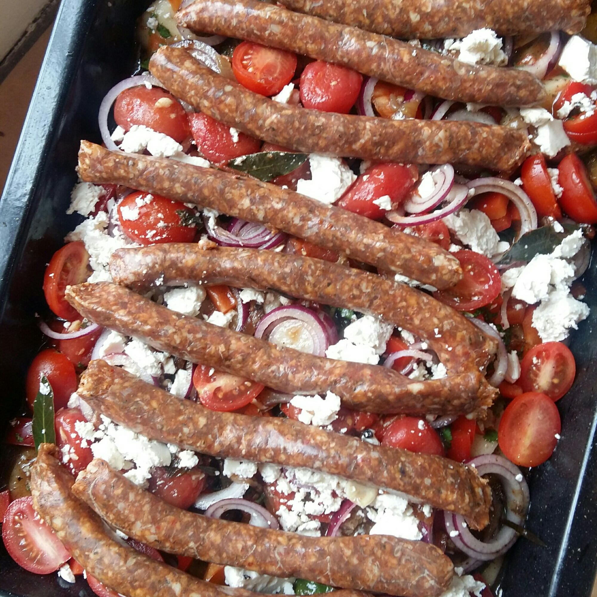 Lay sausages on top